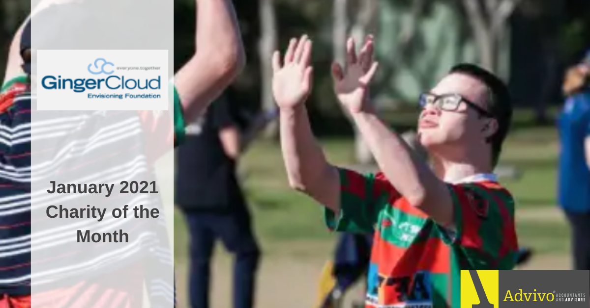 People raising hands on an activity- January 2021 Charity of the Month Image