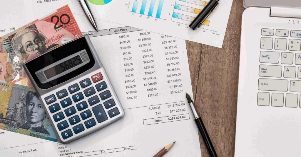 Calculator on money and invoice - Tax Planning Strategies for Your Business Image