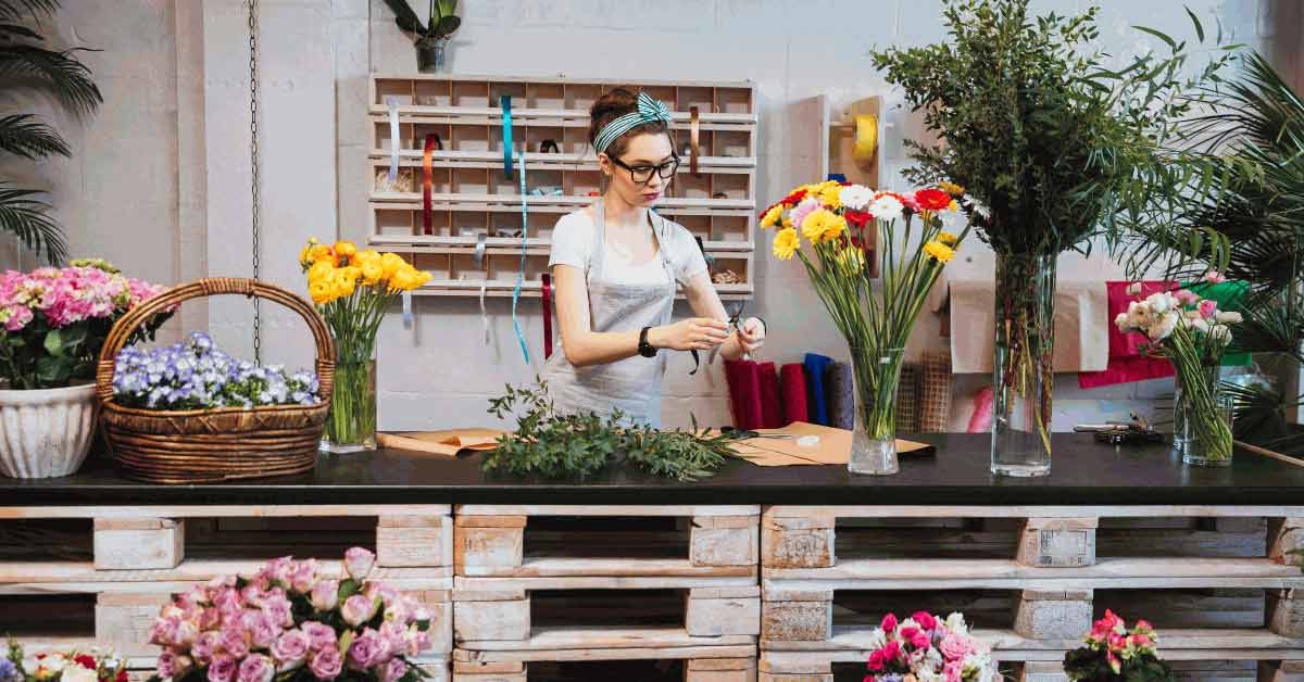 Florist casually arranging herbs and flowers on the table - Stricter Provisions for Casual Employment Image
