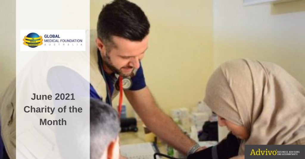 Medic checking woman's blood pressure - June 2021 Charity Image