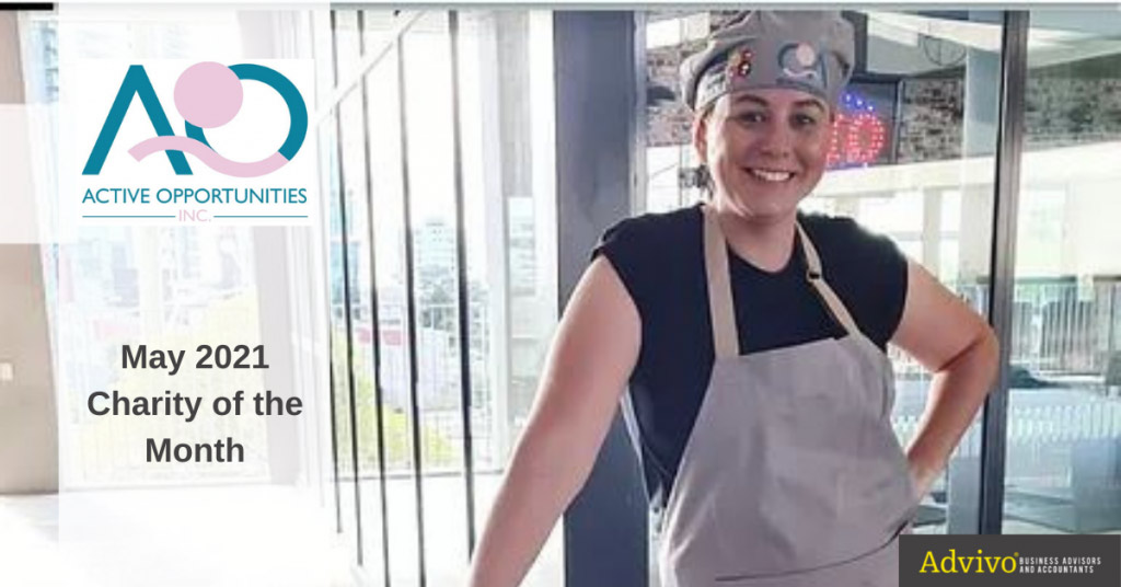 Woman posing with an apron and chef's hat - May 2021 Charity of the Month Image