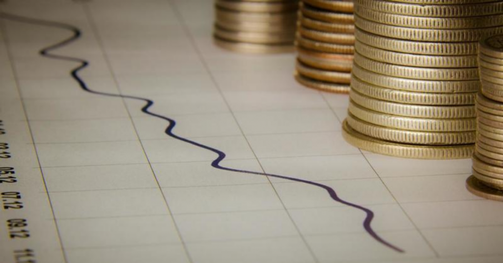Coins in a Paper With Statistics Cashflow Forecast Blog Image Advivo Business Advisors & Accountants